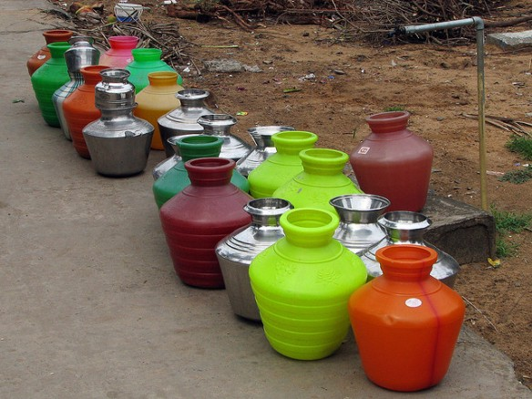Water Pots lined up at a communal tap